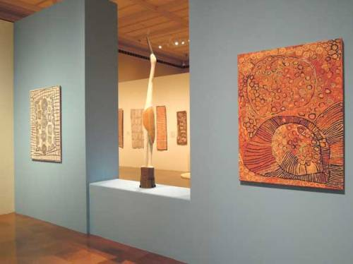 Installation image of Crossing Cultures at the Toledo Museum of Art, showing Patrick Tjungarrayi's Illyatjara 2001 (left) and Naata Nungurrayi's Marapinti 2005 (right).